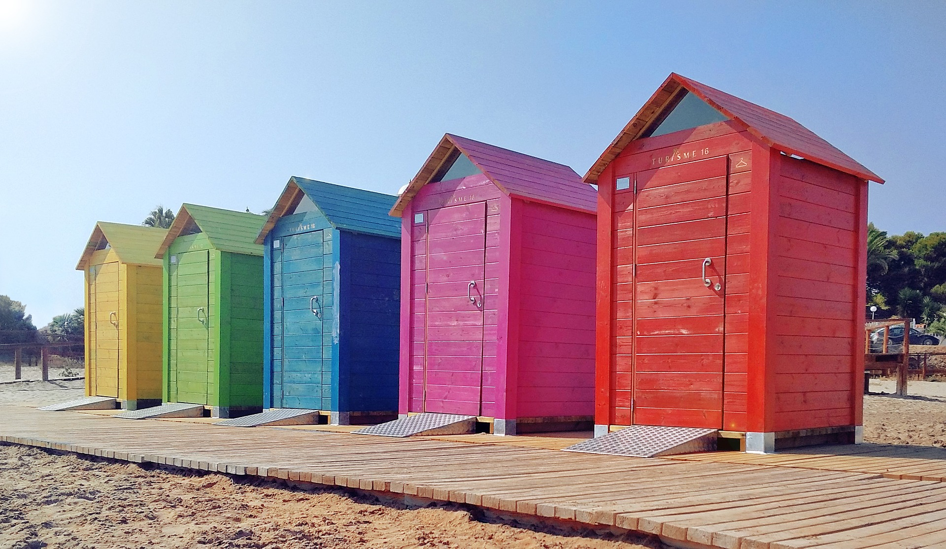 Colourful beach changing rooms