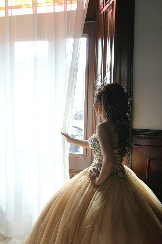 quinceañera looking out the window